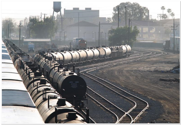 Bakersfield High School is seen in the background behind the rail cars that go through town as viewed from the overpass on Oak Street.  By Casey Christie / The Californian